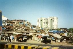 medium_India-Mumbai-aka-Bombay-slums-next-to-high-rise-flats-buggies-1-NC.jpg