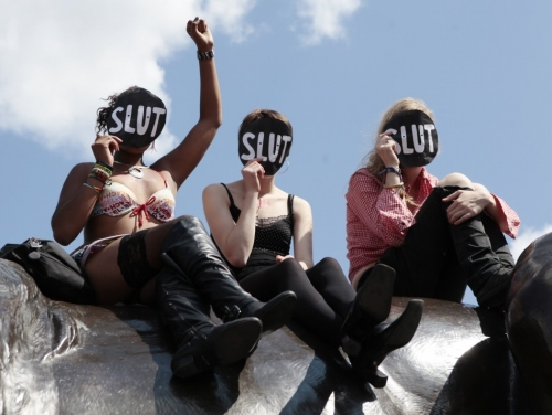117265-slutwalk-participants-cheer-a-speaker-after-walking-from-hyde-park-cor.jpeg