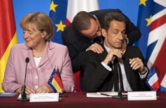 berlusconi-4-italian-prime-minister-berlusconi-speaks-with-france-s-president-sarkozy-and-german-chancellor-merkel-at-elysee-palace_182.jpg